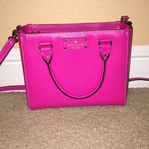 Pink Kate Spade purse with cross body strap